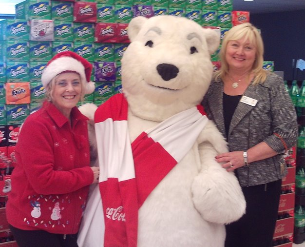 The Coca Cola Caravan And The Dancing Polar Bear Visited Dunkirk, MD, Giant #325, Greeting Customers And Associates And Giving Store Manager Debbie And Cindy A Holiday Hug