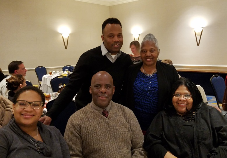 Dominique Coates With Family Members After Winning An Award From Arc Central Chesapeake Region For Being A Champion For Those With Intellecutal Disabilities