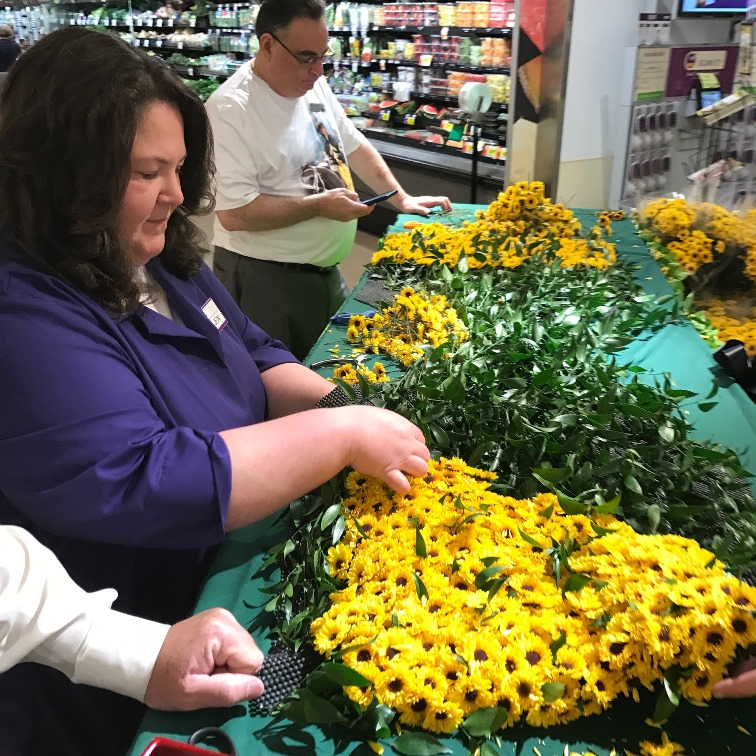 Assembling the winning floral blanket for the winner of the Preakness Stakes