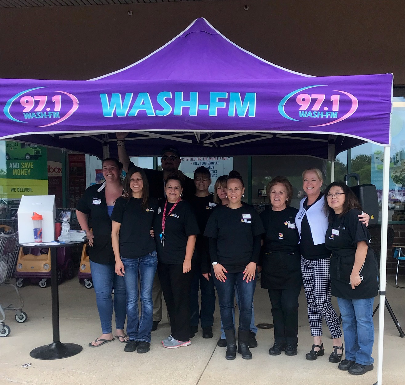 Local Radio Station 97.1 WASH-FM At Store #359 Promoting The BBQ Battle
