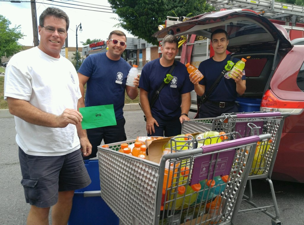 """Giant 350 Helped The Local Fire Department """"Beat The Heat"""" By Asking Their Customers To Donate A Bottle Of Gatorade. Pictured Are Members Of Hillandale Station 12 Receiving The Second Group Of Donations. Giant Was Able To Collect About # 350 Bottles Of Gatorade."""